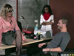 Xander is in detention with another ebony student and blonde teacher Peyton, is in charge. However, horny milf has entirely different ways of giving detention. She flirts with the boy, while the ebony watches. And soon, the lustful blonde lady with amazing big tits, goes on knees and starts sucking his cock.