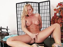 Silvia Saint does striptease before masturbating with passion