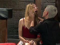 This lesbian domme is in control of Emma and she is going to dominate her. Before they get started, they have to set the ground rules for safe domination play. They get their safewords ready and then begin. Emma has her hair pulled and she is lightly choked by her mistress.