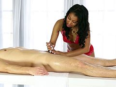 An ebony babe gives him a rubdown then sucks his cock