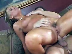 Oiled up pornstar Flower Tucci moans under horny dude penetrating her anus