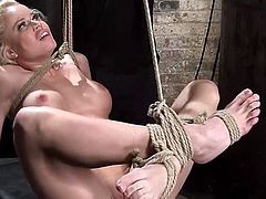Crazy babes like Nikki Delano, love when lusty pleasures combine with hot thrills and pain. Click to watch the naked bitch with nice tits tied up strongly in a creative rope bondage, that makes her completely helpless. She obeys and sucks the long dildo, with which the dominant guy stimulated her cunt before...