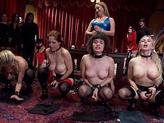 Four slutty slaves wearing stockings, are the main attraction of this kinky party and their blonde domina, is supervising their performance for the pleasure of the crowd. Bare titties whores are sitting together, while their mistress come spanking and pinching them, with making them doing kinky things. Watch!