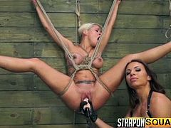 If you're attracted to slutty babes who love tough bdsm practices, dare to click and enjoy the sight of helpless Marsha's wet cunt... The naked blonde is tied up with ropes, so her dominant lesbian companion can easily have access to her pussy. The game would not be complete without a dildo and a strap on.