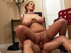 Busty cougar Eva Notty with sexy lingerie under her coat seduces a guy. He grabs her big breasts and she sucks his cock. Then she pulls down her panties and rides his hard cock.