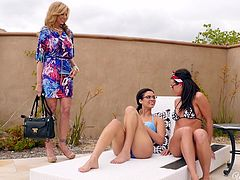 Two ladies with perfectly fit bodies are joyfully chatting in the yard, when a blonde-haired milf makes her appearance. Busty Julia seems excited to meet her old naughty friends, who offer her a warm welcome. Inside the house, the bitches get rid of clothes and kiss. It's the beginning of a promising weekend.