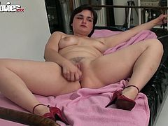 Busty BBW beauty poses and masturbates with her new dildo.