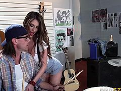 Brunette babe Dillion, comes to the store, looking for some musical instrument. Instead, she finds herself a dork shop boy Johnny, with a hard big dick. Seeing the chick's big boobs and pink nipples, he has a boner and slutty babe wastes no time to start sucking his meaty big cock with pleasure.