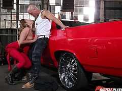 Mia thought it would be a great idea, to match her molded costume with the color of her partner's car and, undoubtedly, she looks brilliant dressed in red and on high heeled boots. Kissing and caressing leads to undressing... See the horny lady on knees sucking cock!