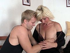Blonde aged  pleases an innocent fellow