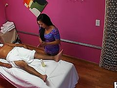 Sexy asian girl works at the massage center. This charming guy comes over and besides a body massage she also delivers a hot handjob.