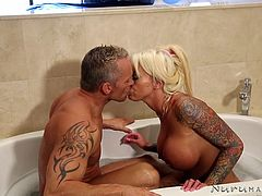 Versed milfs like Lolly know how to offer sensational thrills to their partners. A relaxing bath in the tub opens the way to exploring this bitch's big boobs and perfect body. After that, the tattooed slut invites the horny guy in the bedroom, where she can massage his back and suck his dick with dedication.