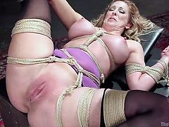 Slutty Cherie is the new sex slave, which has been brought in the basement of the Armory... The blonde milf finds herself helpless in front of a severe executor, who spices up the atmosphere by using a dildo and a vibrator, to raise her pleasure to another level. Clothespins are also attached to her cunt. See!