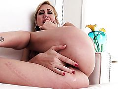 Brett Rossi takes dildo in her bush