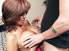 Tara Holiday is a hot milf that likes a young cock in her cunt. She gets fucked from the back and rides that dick like a crazy bitch that she is.