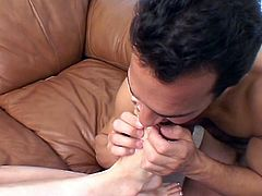Young brunette gets her toes licked before giving big dick a foot job