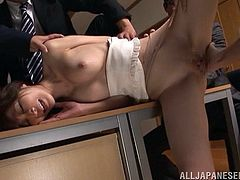 A group of guys finger her pussy on a conference room table