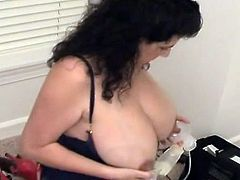 Very big breasts & nipples with milk on sexy large woman
