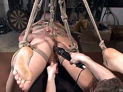 Are you fond of gay bdsm activities? Dare to click and see a slutty stud, tied up strongly in a rope bondage. Derek is wearing a ball gag. His face expresses pleasure mixed with pain, while he's enjoying a kinky handjob, performed by a fierce dominant partner, who also uses a vibrator. Don't miss the details!