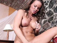 Silvia Saint has fire in her eyes as she fingers her vagina