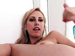 Brett Rossi with massive hooters and trimmed pussy masturbates to orgasm in solo scene