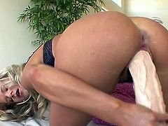 Long legged blondie Bianca Lovely rides fake thick cock with passion