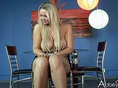 Stunning blond bombshell Abbey Brooks sucks her nipples and plays with cunt