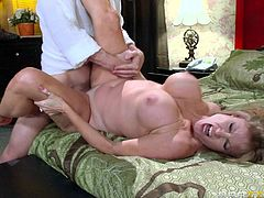 Sex starved MILF Darla Crane with incredible huge tits makes hard cocked guy happy in the comfort of the bedroom. She gets her slit banged with legs apart after foreplay. Watch and enjoy!