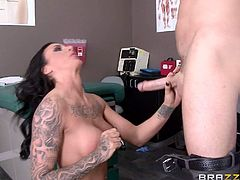 Perfect bodied busty brunette Austin Lynn with tattoos and piercings gets nude at doctors office and takes his hard dick in her shaved pussy eagerly. Dr. Sin bangs her fake boobs and drills her wet vagina.
