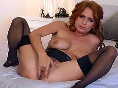 Naturally titted good looking redhead Ashlee Graham in black nylon stockings makes her beautiful eyes on camera as she finger fucks her pink snatch with legs apart in the bedroom.