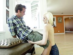 Beautiful blonde Elsa Jean on her knees orally servicing a guy