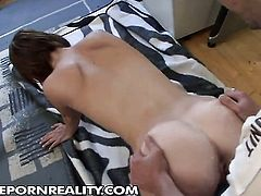 Redhead with big melons is in heaven eating guys erect cock