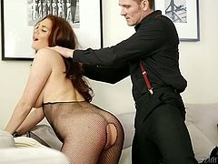 Blue eyed babe in crotchless body fishnet gives sensual blowjob to one lucky dude
