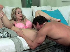 Who can say No to this beautiful busty MILF Brandi Love takes off her dress and pink lingerie in front of a hot guy and spreads her legs to let him lick her nice juicy pussy.