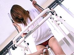 This dirty slut was working out on the eliptical machine in the school gym, when I came in and surprised her with a hitachi vibrator. I put the vibrator on her pussy and pressed hard. I could see the juices dripping into her shorts. She moaned with pleasure.