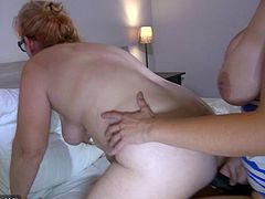 Charming busty pigtailed blondie fucks old cunt of Bernadett with strapon