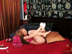 Blonde wench Avril Hall strips and plays with herself for your viewing enjoyment