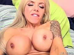 Buxom blond lady loves rubbing her clit with fancy white vibrator