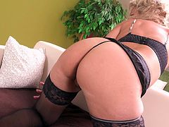 Do you often fantasize about horny milfs? Milena is a sensual bitch with nice tits, which she slowly reveals, after removing her sexy bra. The blonde-haired mature slut is wearing kinky black stockings and looks very seducing. Click to see her getting dirty in privacy...