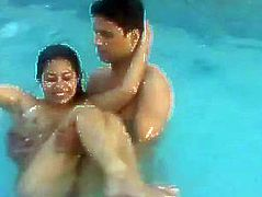 Teen indian students playing nude in pool