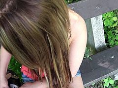 Lovely long haired European girl Barbara Sweet in sexy blue jean mini-skirt flashes her hot boobs outdoors in public place and then gives headjob on a bench in the park. Easy chick!