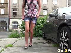 Slim black haired cutie adores pissing near luxury car