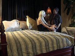 Long haired elegant blonde beauty Tanya James dressed in black does her bets to bring Randy Spears to the edge of nirvana in the bedroom. Watch breathtaking lady make love!