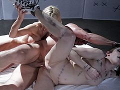 Tattooed Asphyxia Noir and the experienced milf with massive fake milk cans, Jessica Drake, are going to have their tight A-holes penetrated by a big white pulsating shaft in a hot threesome sexual video