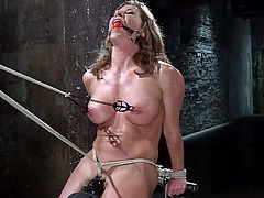 A fierce dominant guy has found the right way to punish a dirty bitch. See nasty Ariel tied up with an inescapable rope bondage, after her pussy is aroused with the use of a vibrator. The slut is also wearing a kinky ball gag and her nipples hurt. Watch the executor playing with her peachy cunt!