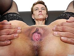 When she opens up her thighs, you can see deep inside this old Euro babe's pussy. She is very experienced with sex and after years of fucking, her cunt is so loose, that she can put a huge dildo deep up inside of there.