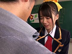 Naughty Asuka is wearing a kinky school suit, which makes her looks really hot. Click to watch the brunette slutty Japanese on knees, sucking her lover's cock with enthusiasm. This sexy babe is about to get pounded hard from behind right in the classroom. Have fun!