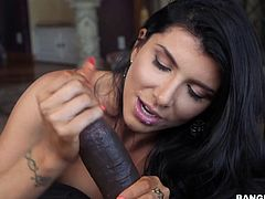 Naughty Romi's lusty desires are finally catching shape, where she finds herself in the presence of an ebony partner, blessed with a huge cock. See the smokey tattooed brunette, sucking it passionately and then, riding it like a tigress. Enjoy the sexy details!