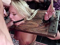 A restrained bitch is persuaded to suck a horny guy's cock. See her pussy aroused with the help of a kinky vibrator, while another hot blonde bonded slut is banged hard from behind. Don't miss the details!