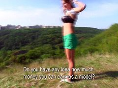 Nice amateur girl Tess Lyndon strips down to her black underwear in nature under the open sky. She poses on camera for cash. Shes an easy girl who is short on her dough.